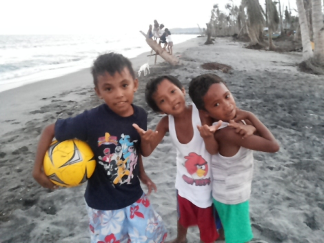 Kids of Tolosa, Leyte still look cheerful after Typhoon Yolanda damaged their homes.