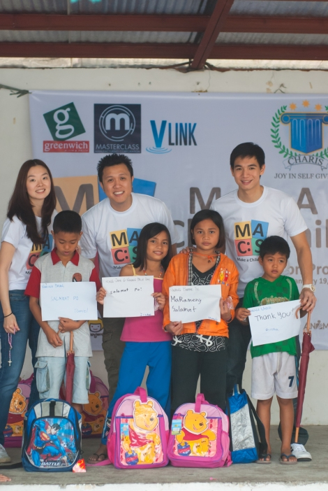 Lucky kids with their school supplies from their MACS Ninong/Ninang.