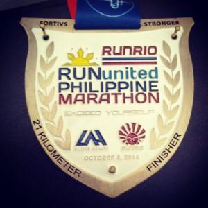 Officemate and duathlete Earl Guzman's RunUnited Philippine Marathon 21K medal