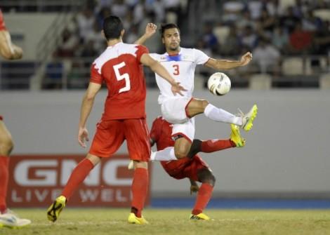 Stephan Palla contests for the ball vs. Bahrain.