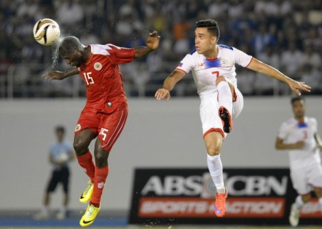 Iaian Ramsay (right) lurks behind a Bahraini defender